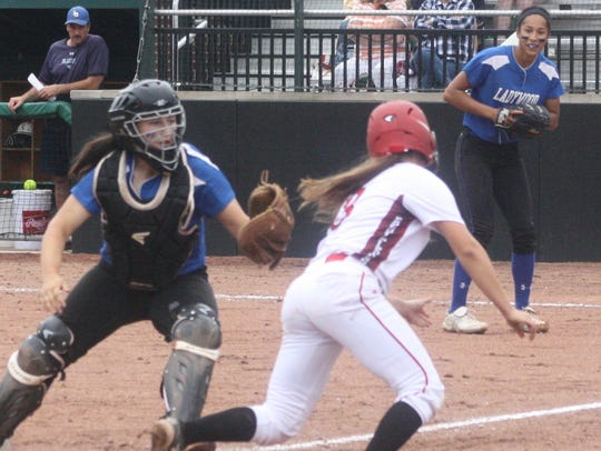Ladywood catcher Michaela Warner tags out a Vicksburg