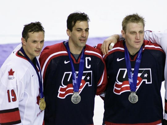 From left, Team Canada's Steve Yzerman, Team USA's Chris Chelios and Brett Hull and Team Canada's Brendan Shanahan pose for a picture after Canada defeated USA to win the gold medal in the 2002 Winter Games in Salt Lake City, Utah.