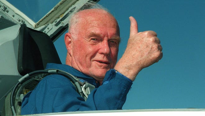 Astronaut and senator John Glenn gives a thumbs up sign after arriving October 26 at the Kennedy Space Center for his October 29 scheduled launch aboard the US Space Shuttle Discovery for a nine-day mission.  Glenn, who was the first American to orbit the earth in 1962, at age 77 will the oldest man to fly in space.
