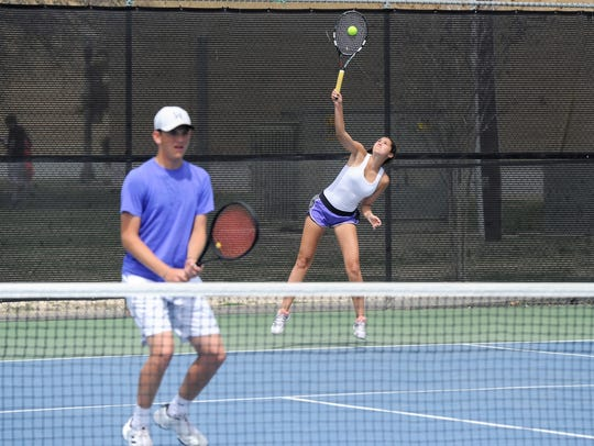 Wylie's Kaitlyn Hathorn serves behind mixed doubles