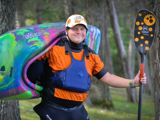 Rural Clear Lake kayaker Brian Imholte poses with his freestyle kayak Saturday, Sept. 3, 2016, at Warner Lake County Park.
