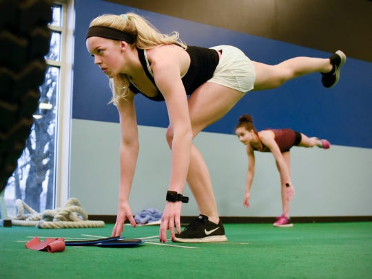 Sofie Streich, 15, and  Madelyn Anderson, 11,  stretch
