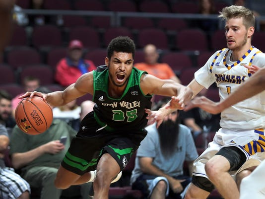Utah Valley guard Kenneth Ogbe (25) drives to the basket past Cal State Bakersfield guard Brent Wrapp (1) during the first half of an NCAA college basketball game in the Western Athletic Conference tournament Friday, March 10, 2017, in Las Vegas. (AP Photo/L.E. Baskow)