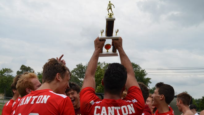 Canton celebrates winning the 2016 Gary Balconi Soccer Tournament. This year's tourney begins 10 a.m. Saturday at Plymouth-Canton Educational Park. Eight teams will compete on four fields.