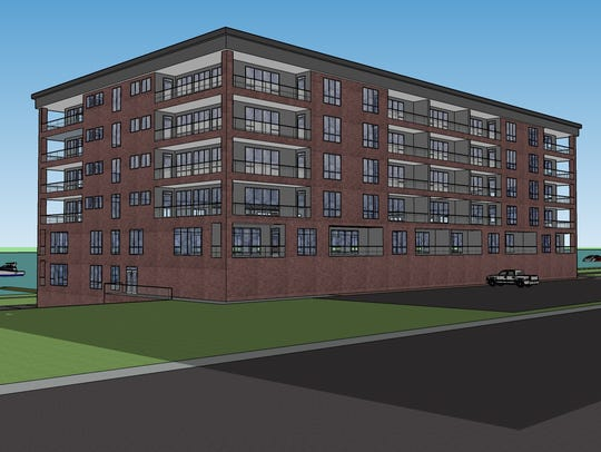 A rendering of a proposed 52-unit condominium building