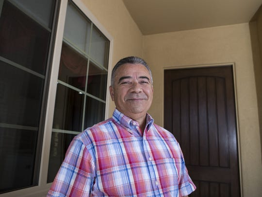Tony Munro poses outside his house on Friday, June 30, 2017 in Sun City West, Ariz.