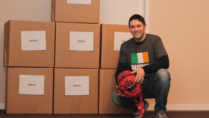 John Fitzgerald of the Baseball United Foundation with some of the boxes destined for Kenya.