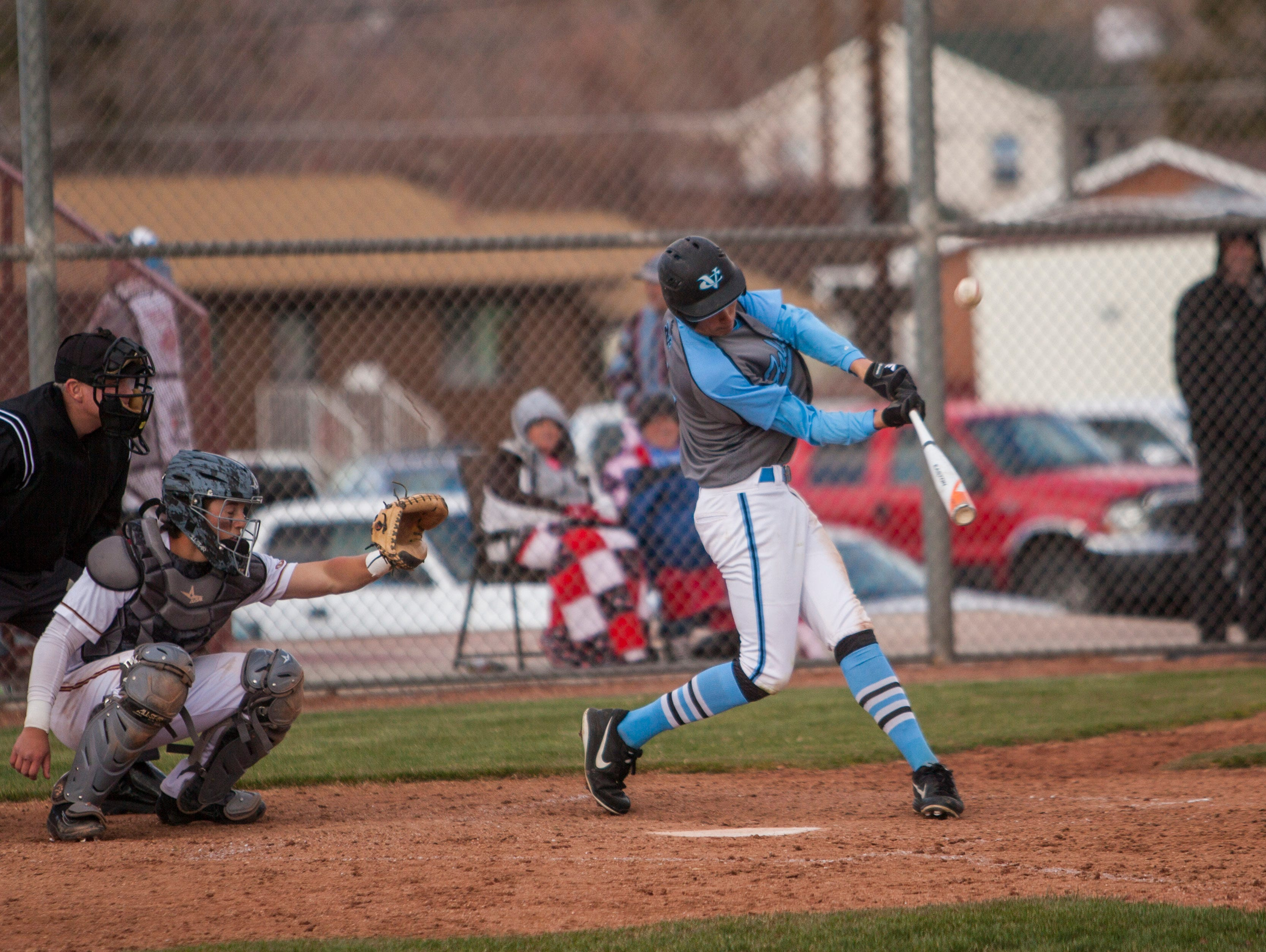 Canyon View's Tyler Hardin connects with a pitch during the game at Cedar High, Thursday, Mar. 31, 2016.