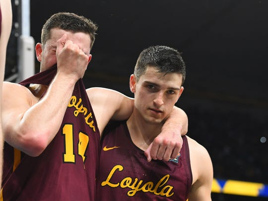 Loyola guards Ben Richardson (14) and Clayton Custer
