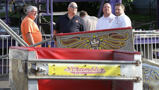 """Department of Homeland Security and the Beech Grove Fire Department inspect """"The Scramble"""", an amusement park ride at the Beech Grove Fall Festival Thursday, September 15 2016, morning in Beech Grove. A teenager was injured Wednesday night when a metal bar with lights on it broke free and hit the 17-year-old."""