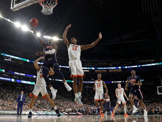 Auburn's Jared Harper goes up for a shot against Virginia's De'Andre Hunter during an NCAA Tournament game on April 6.