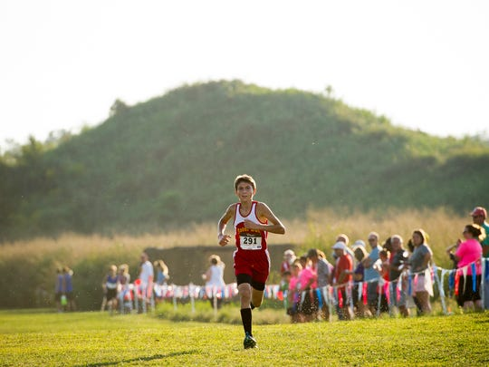 Mater Dei's Dawson Schroeder wins the boys' varsity 3k race with a time of 10:42.9 during the 7th annual Run at the Mounds cross country meet for middle school runners at Angel Mounds in Evansville on Tuesday.