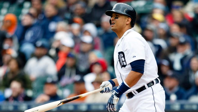 Detroit Tigers designated hitter Victor Martinez hits a sacrifice fly in the first inning against the New York Yankees at Comerica Park.