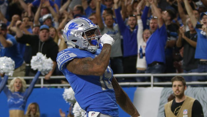 Kenny Golladay celebrates his first career touchdown in the fourth quarter of the Lions' 35-23 win over the Cardinals in the opener Sunday, Sept. 10, 2017 at Ford Field.