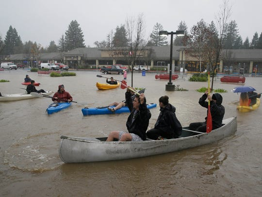 People use kayaks and a canoe to make their way around