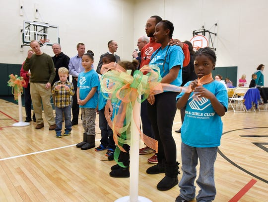 Children take part in the ribbon cutting ceremony Thursday