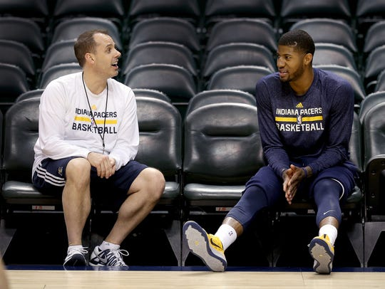 FILE -- Pacers coach Frank Vogel and Paul George during their 2014 playoffs series against Atlanta.