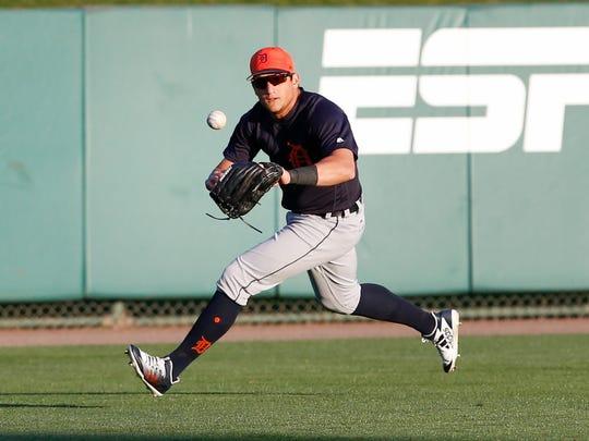 Tigers left fielder Mike Mahtook  fields a ball during