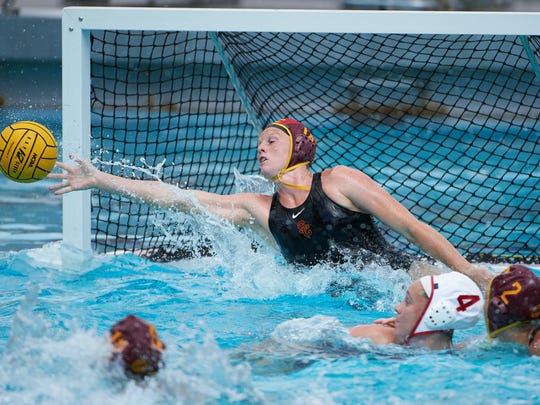 USC goalkeeper Amanda Longan, a Moorpark resident and Oaks Christian graduate, makes a save in the NCAA championship game against Stanford on May 13 in Los Angeles. USC won 5-4.