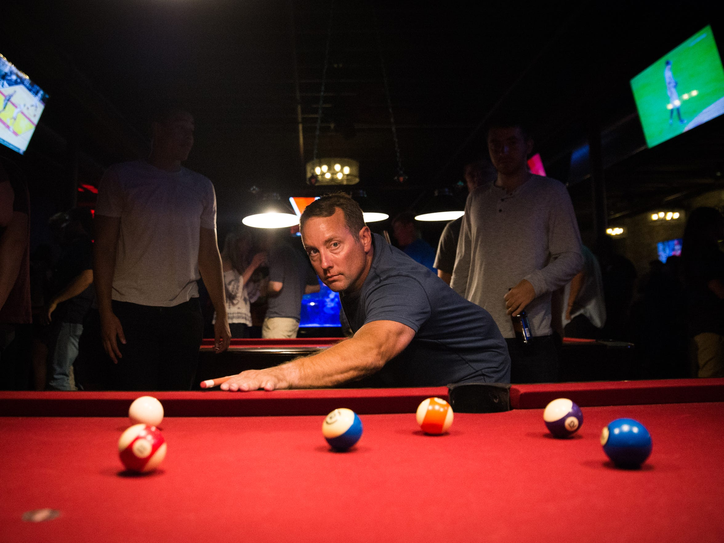 Dan Johnson of New Baltimore plays pool at the Fifth Avenue nightclub in Royal Oak, Mich. on Friday, July 20, 2018.