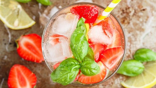 Summer a refreshing lemonade. Drink with lemon, strawberries, mint, Basil and ice. Detox. Mineral water. Selective focus