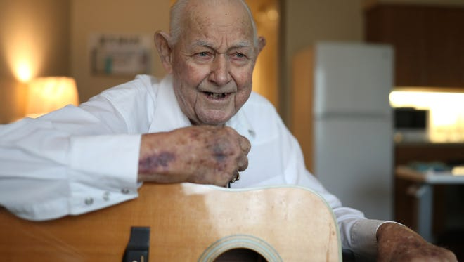 """Lloyd """"Hoot"""" Gibson poses for a portrait with his guitar at the Tapestry Senior Living of Tallahassee Friday, July 20, 2018,"""