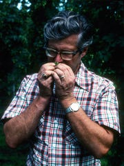 Dr. Alfred Haunold, hops geneticist, smells Cascade hops in the 1980s. Haunold released the Cascade hop in 1971, which became a very popular craft brewing variety.