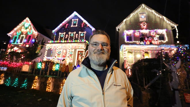 Chuck Barringer set up a Christmas light show with music and animated lights at his North Kensico Ave., White Plains house, center, and included his neighbors' houses in the show Dec. 1, 2016.