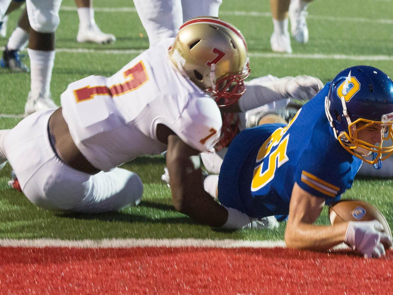 Oxford's Ken Presley takes it across the goal line for six points as Lafayette's Quin Jones tries to stop him.
