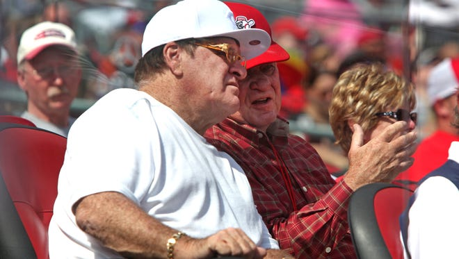 Hit King Pete Rose (left) watches the Reds with team CEO Bob Castellini.