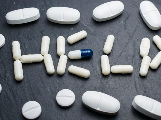 englih word HELP written with pills surrounded by other pills