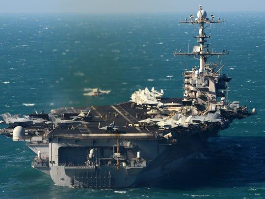 The aircraft carrier USS John C. Stennis conducts flight