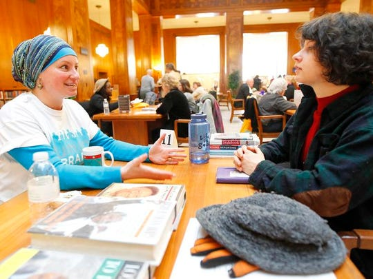 """Debs Doguid-May, left, talks about growing up in South Africa under apartheid with Noelle Evans of Rochester at Saturday's """"Human Library"""" event."""