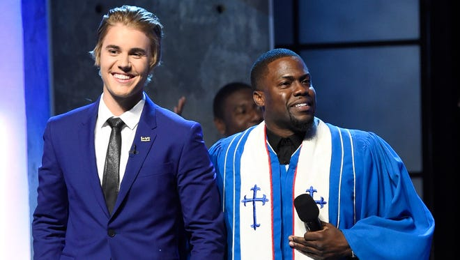 Honoree Justin Bieber and roastmaster Kevin Hart are in the spotlight during the taping of a  The Comedy Central Roast of Justin Bieber at Sony Pictures Studios on March 14 in Los Angeles.