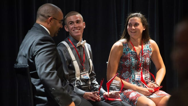 Multimedia sports reporter at Treasure Coast Newspapers/TCPalm Jon Santucci (left) interviews the male athlete of the year, Caleb Pottorff, of Lincoln Park Academy, and the female athlete of the year, Elizabeth Moberg, of Martin County High School, during the TCPalm Sports Awards at the Sunrise Theatre on Monday, May 22, 2017 in Fort Pierce.