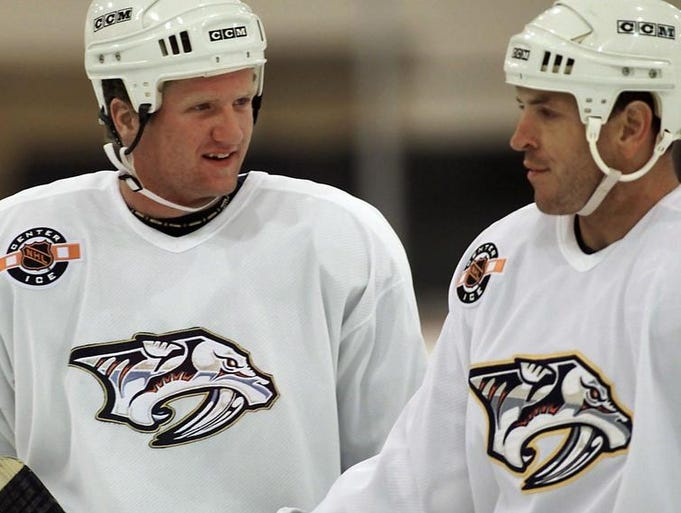 Nashville Predators first choice in the 2000 entry draft, Scott Hartnell, left, talks with Predators team captain Tom Fitzgerald as they warm up for the beginning of training camp Sept. 8, 2000.