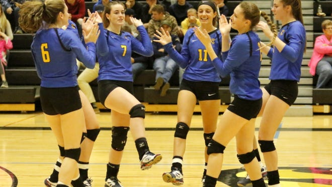 Tioga players celebrate after taking the second set against Trumansburg in the Section 4 Class C Nov. 4 at Corning-Painted Post High School.