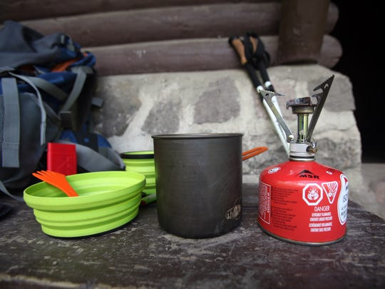 A Sea to Summit X-Bowl, a spork. a GSI pot and an MSR Pocket Rocket stove are good items for backpacking.