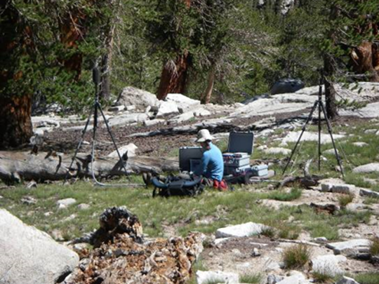 Researcher measuring sounds in the wilderness. (Photo courtesy National Park Service.)