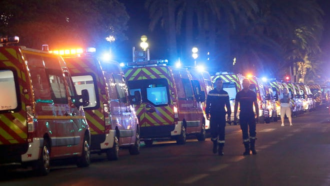 Ambulances line up near the scene of an attack after a truck drove on to the sidewalk and plowed through a crowd of revelers who  gathered to watch the fireworks in the French resort city of Nice.