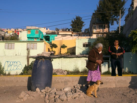 Selerina Guadalupe Villa, 85, talks with her neighbor,