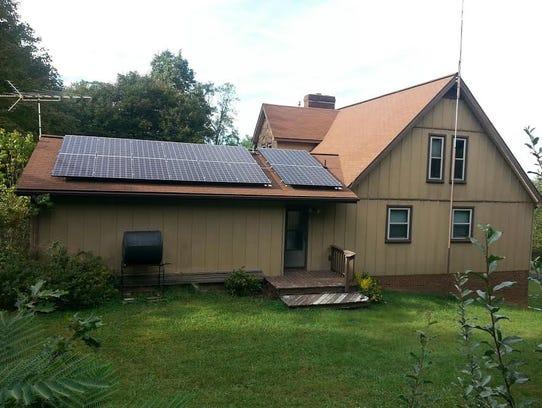 Mount Solon's Wayne Nolde helped put this rooftop solar