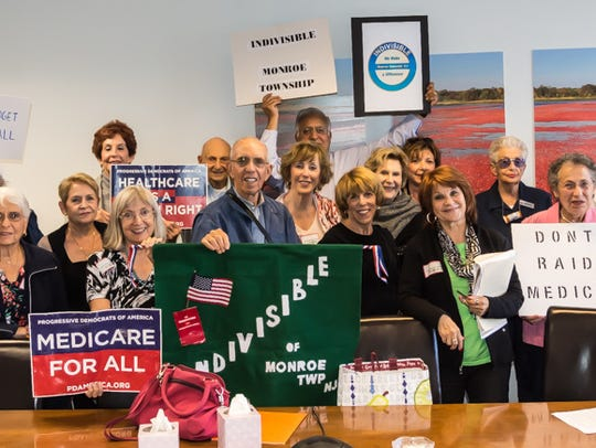 Indivisible members with George Helmy, state director