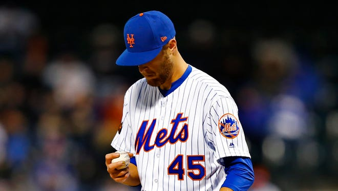 New York Mets starting pitcher Zack Wheeler (45) pauses before pitching against the Washington Nationals in the first inning at Citi Field.