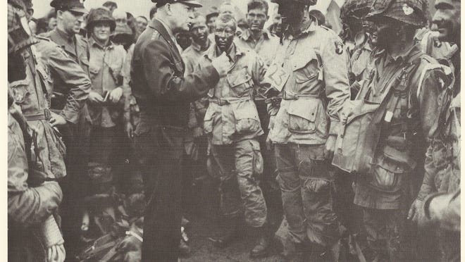 General Dwight Eisenhower speaks to American paratroopers in England on June 5, 1944, one day before they were dropped into France as part of the D-Day invasion. The soldier behind Eisenhower's right hand, Bill Hayes, was from Marathon County.