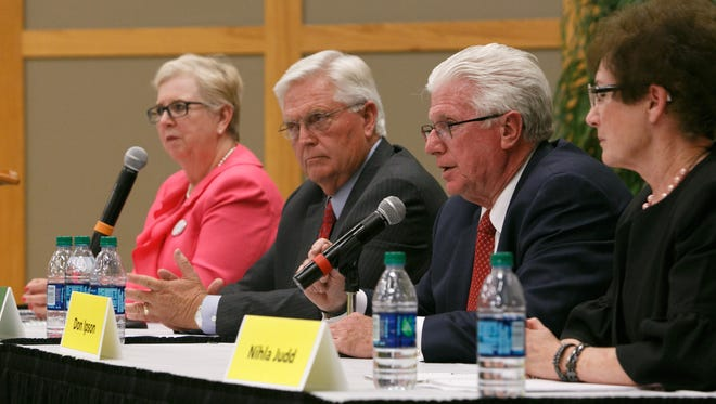 Past candidates for Utah House District 74, Dorothy Engelman (D) and Lowry Snow(R)  and District 75 candidates Don Ipson(R) and Nihla Judd (I), from left to right debate the issues Monday, Sep. 22, 2014 on the campus of Dixie State University.