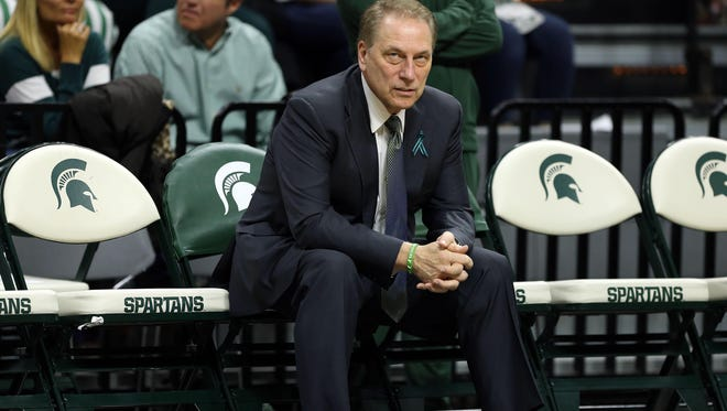 Tom Izzo sits alone before Michigan State's basketball game with Penn State Wednesday night.