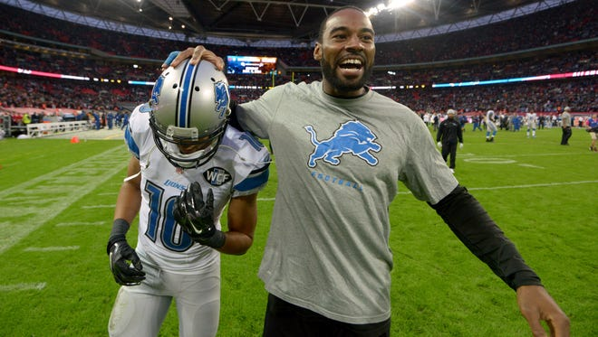 Detroit Lions receiver Calvin Johnson, right, celebrates with receiver Corey Fuller after a game against the Atlanta Falcons at Wembley Stadium.