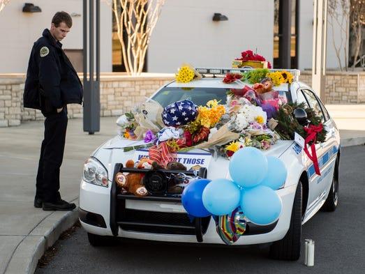Metro Nashville Police officer Brandon Wood visits