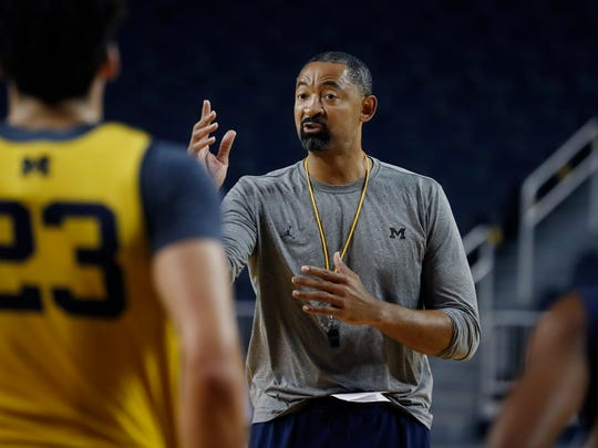 Michigan head basketball coach Juwan Howard attends an open practice, Thursday, Oct. 17, 2019, in Ann Arbor, Mich. Michigan held its men's basketball media day Thursday, another first for Howard as he prepares for his initial season at the helm. The former Fab Five star returned to his school after coach John Beilein left for the NBA this offseason. (AP Photo/Carlos Osorio)